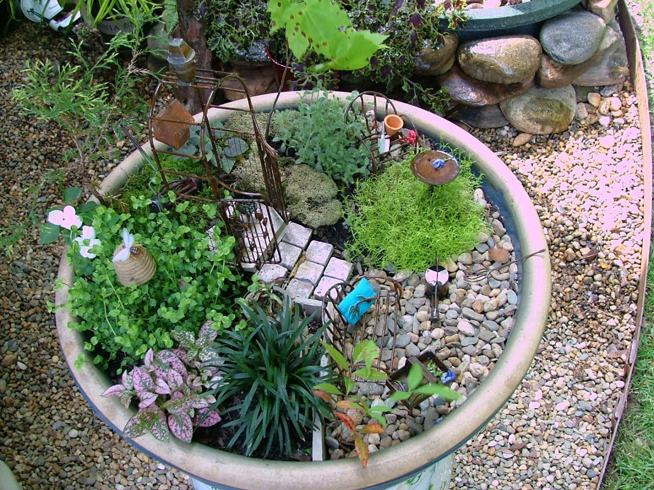 the tiny bee skep, the bird bath, the clay pot and trowel!  no detail left out.