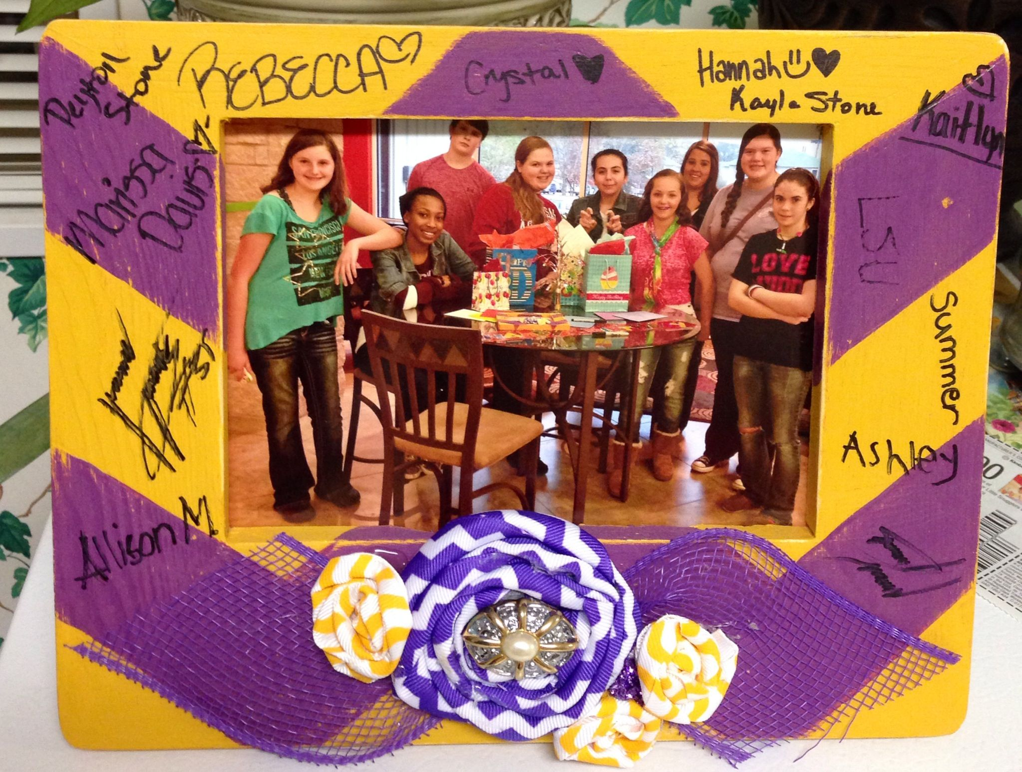 Hand painted picture frame to go along with my daughter's LSU themed surprise party. I had her friends sign it & put their group pic in it.