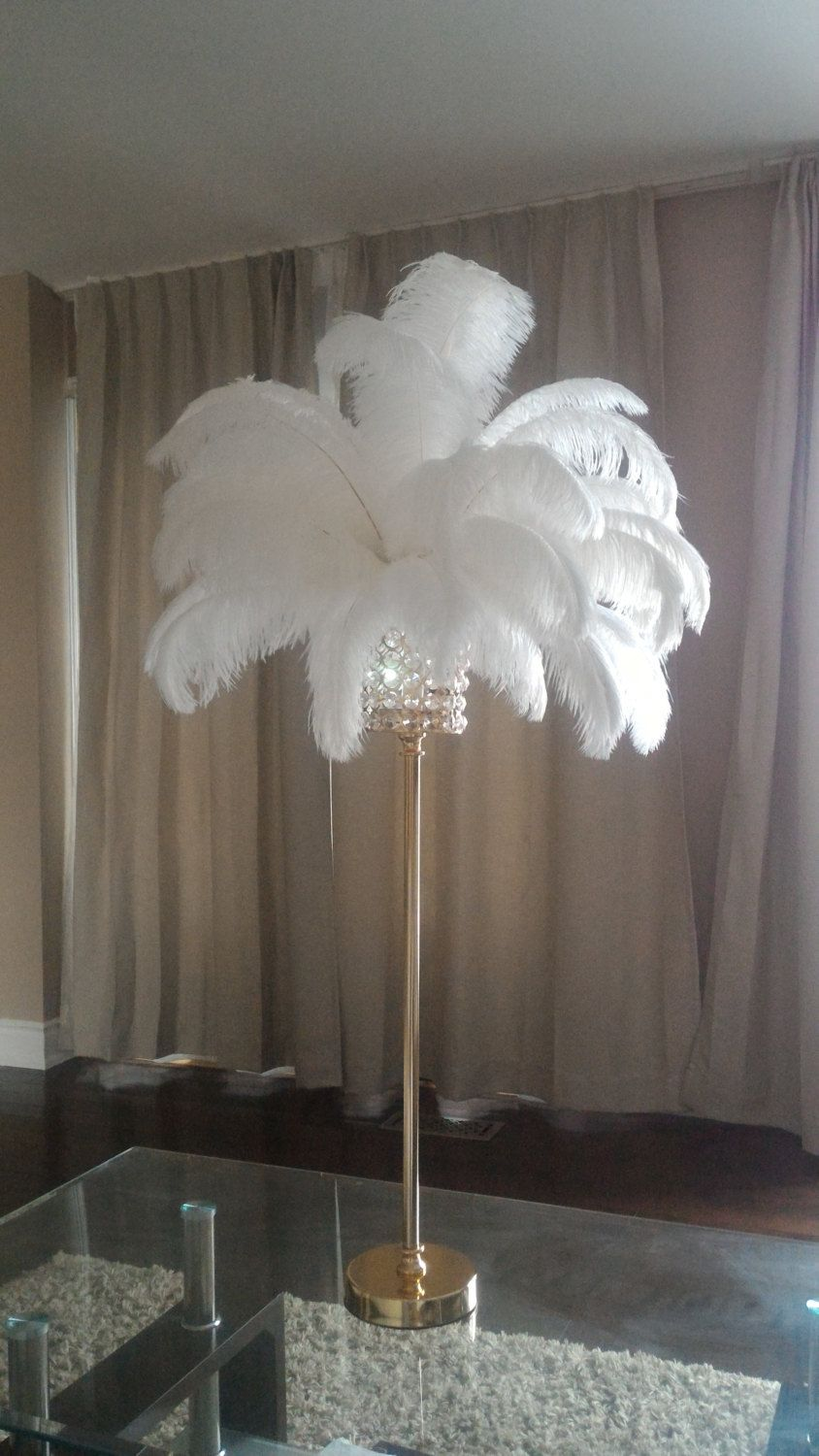 Quot tall gold crystal globe stand ostrich feather