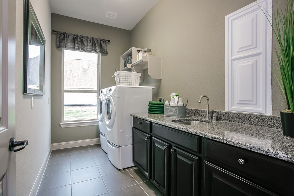 Gehan Homes Laundry Room Storage Storage Space Decorative Laundry Room Washer Dryer Laundry Sink Granite Countert Home New Home Construction Laundry Room