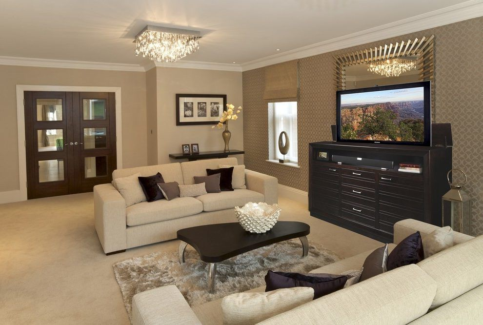 tv lift in the footboard family room traditional with motorized tv