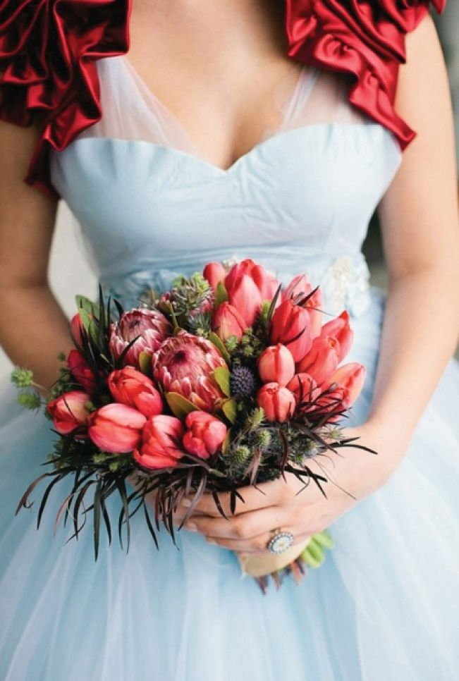 One of the world's most recognized spring flowers with boldly colored cup-shaped blooms, tulips are a perfect symbol of love and new beginnings. Available practically any time of year and less expensive than many other flowers, these are a great choice if you