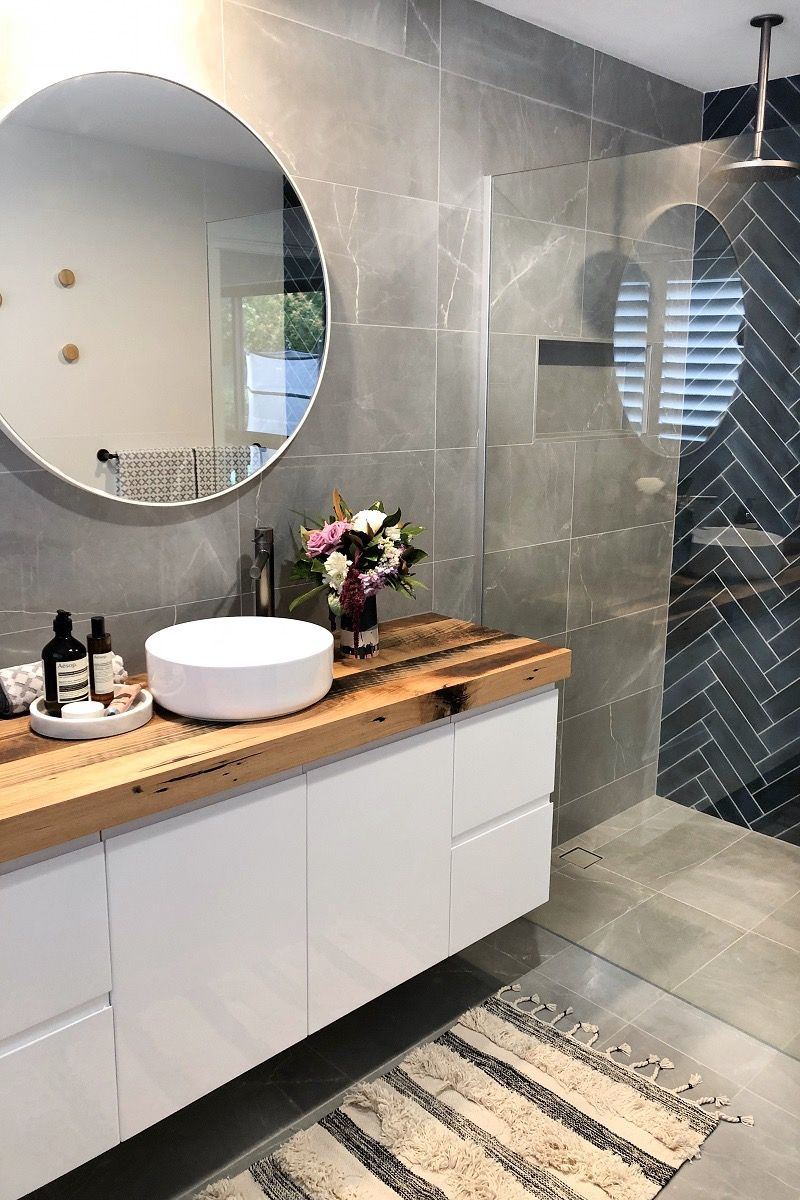 Contemporary bathroom with navy subway herringbone feature wall and grey tiles custom timber vanity sleek tapware also blue charcoal modern luxe twist interior