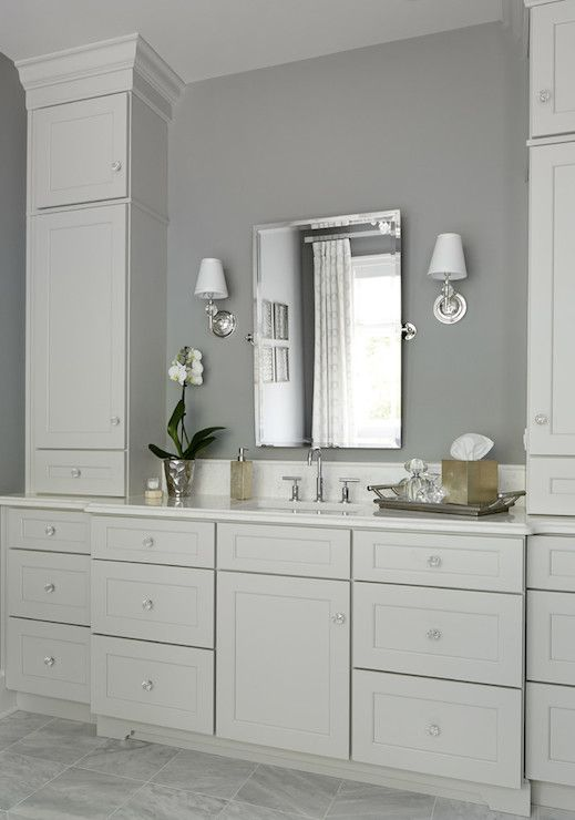 Ivory And Gray Bathroom Features Walls Framing A Rectangular Pivot Mirror Flanked By Restoration Hardware