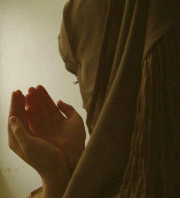 girl while praying .
