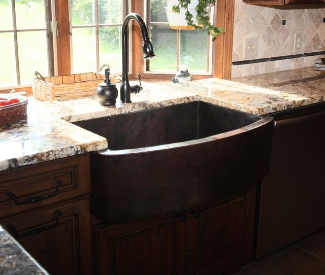 Hammered Copper Apron Front Sink with dark wood and light ...
