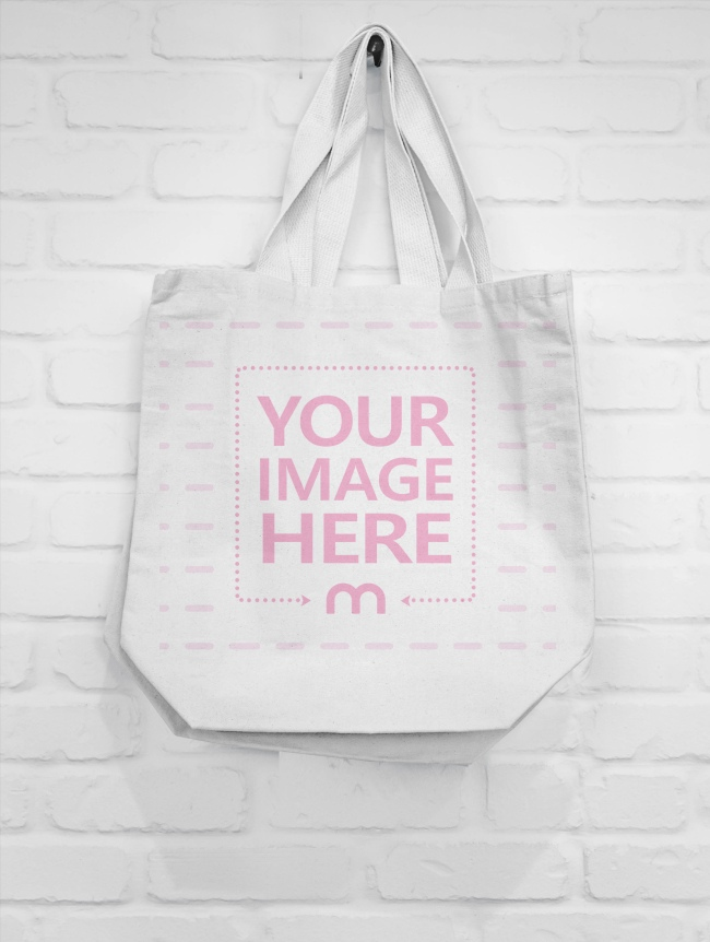 Download An Empty Sack Cannot Stand Upright So That S Why It S Hanging On The Wall A Mockup Template Of A Blank White Tote Bag Hanging On Tote Bag White Tote Bag Tote