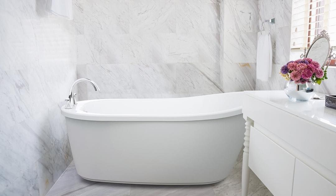 The Piccolo Freestanding Bathtub Paired With A Deck Mounted Tub