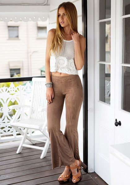 Go on an adventure and bring out your wild side in these super awesome brown suede bell-bottom pants.