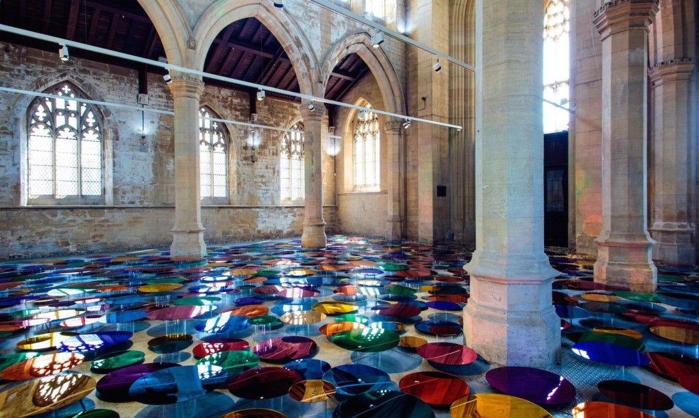 700 colorful mirrors bathe a 19th-century cathedral in gorgeous rainbow light... #lightartinstallation