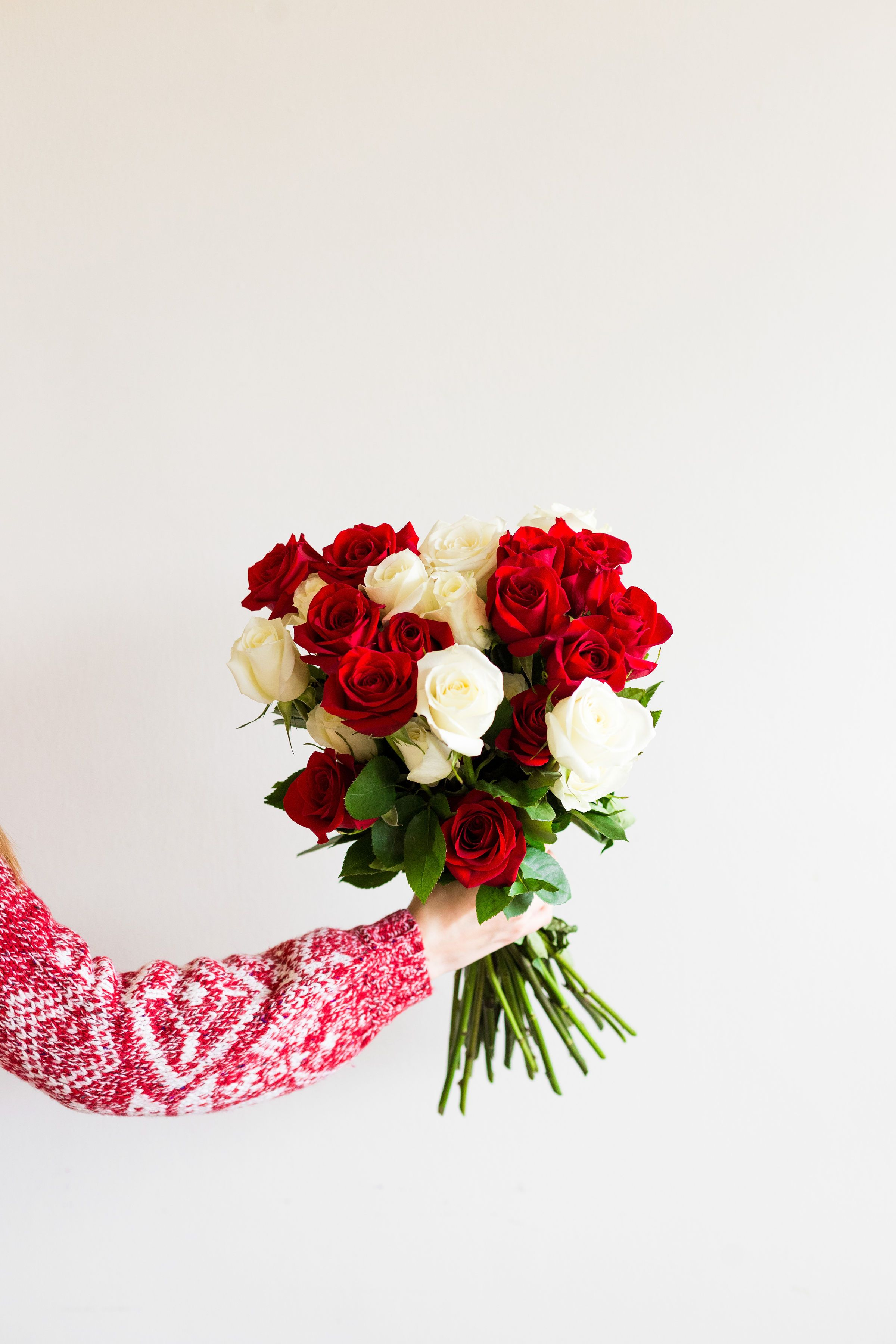 Christmas bouquets that include red and white roses with