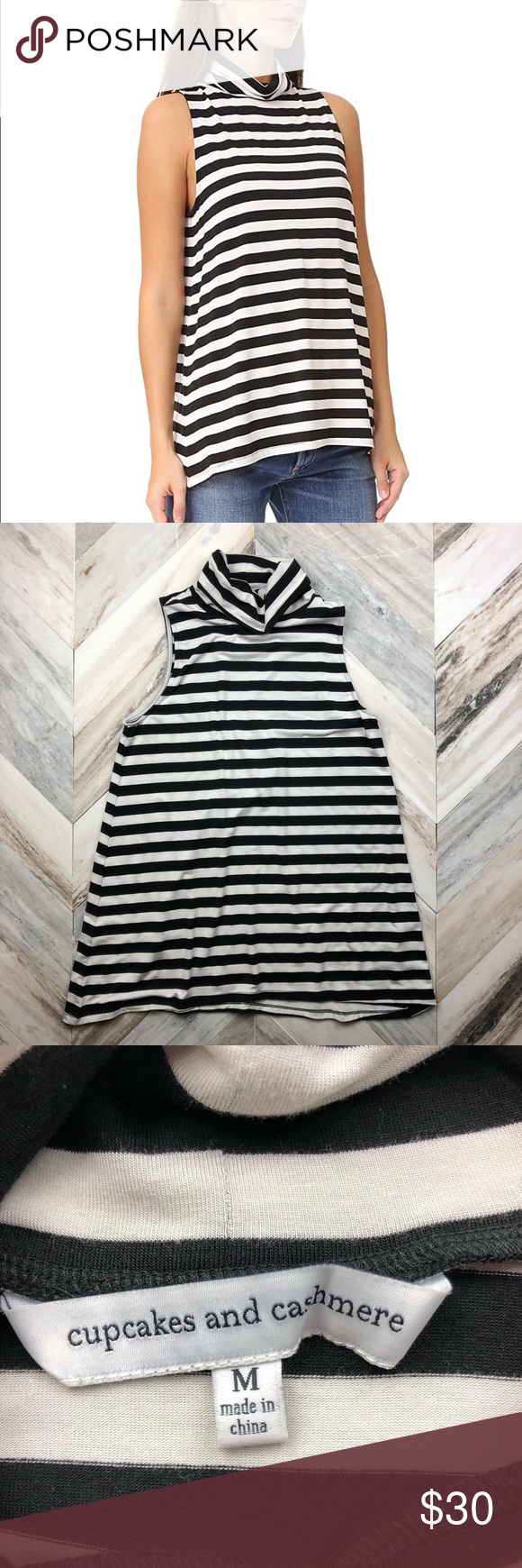 94823db39a Cupcakes and Cashmere Shelene Striped Turtleneck Gently used condition. No  holes or stains. Sleeveless turtleneck tank with black and white stripes.