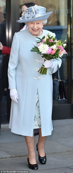 The Queen plumped for a pretty summer ensemble of a blue coat and floral print dress