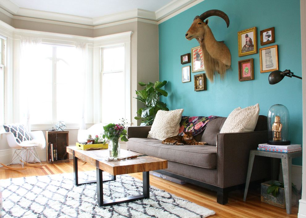 Pea blue accent wall living room eclectic with light hardwood ...