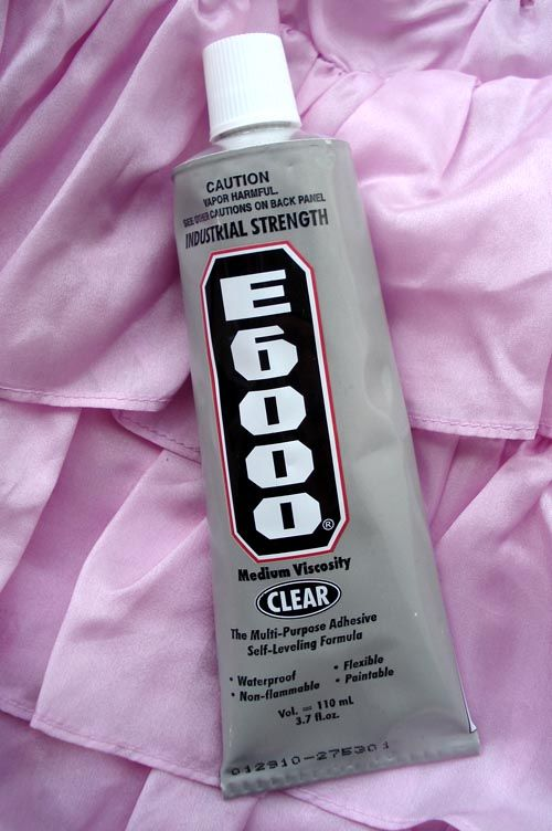 e6000 this glue holds so well.  it can be used for any household project.    I use this for glass on glass, works great for the totem poles I make out of glass for the garden.