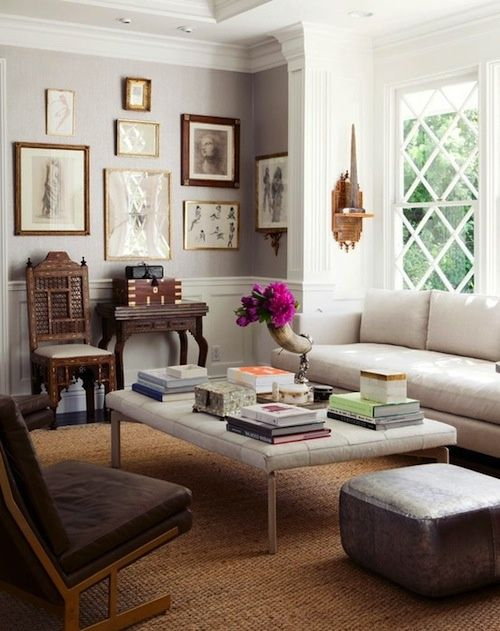 A cozy family room with a wall of art.  (Blog — Providence Design)