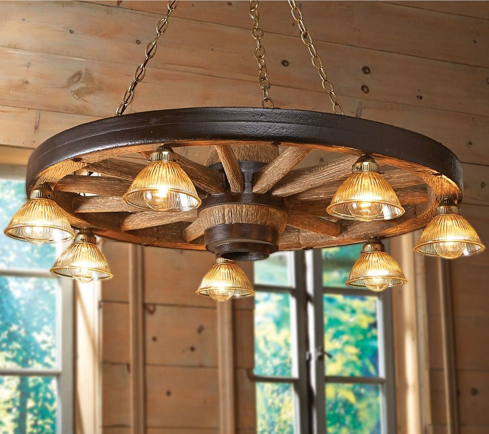 Large wagon wheel chandelier with downlights in 2019 living room