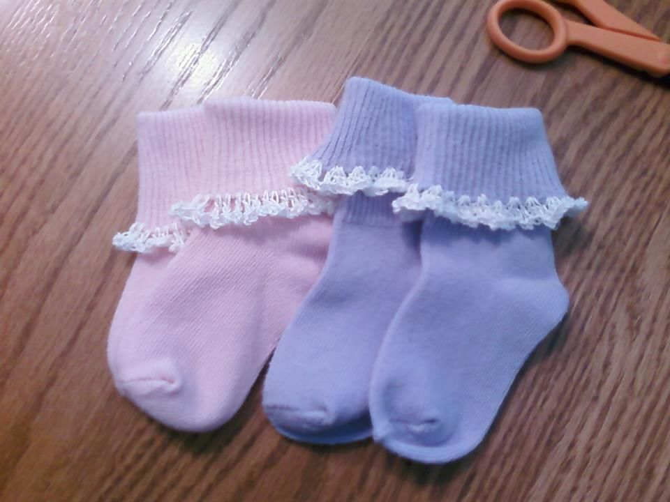 I took a basic pair of socks and made them frilly by crocheting lace around the edge.