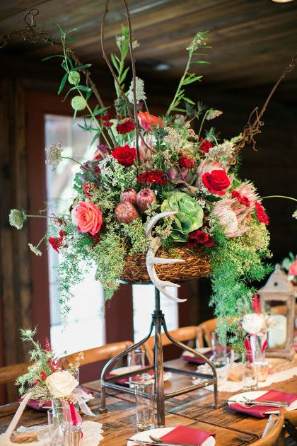 The centerpieces from Connor and Ben's romantic boho wedding are full of organic colors like vintage plum, mauve and reds from Lagniappe Designs! Jessica Gold Photography #bridesofnorthtx #weddings #centerpieces