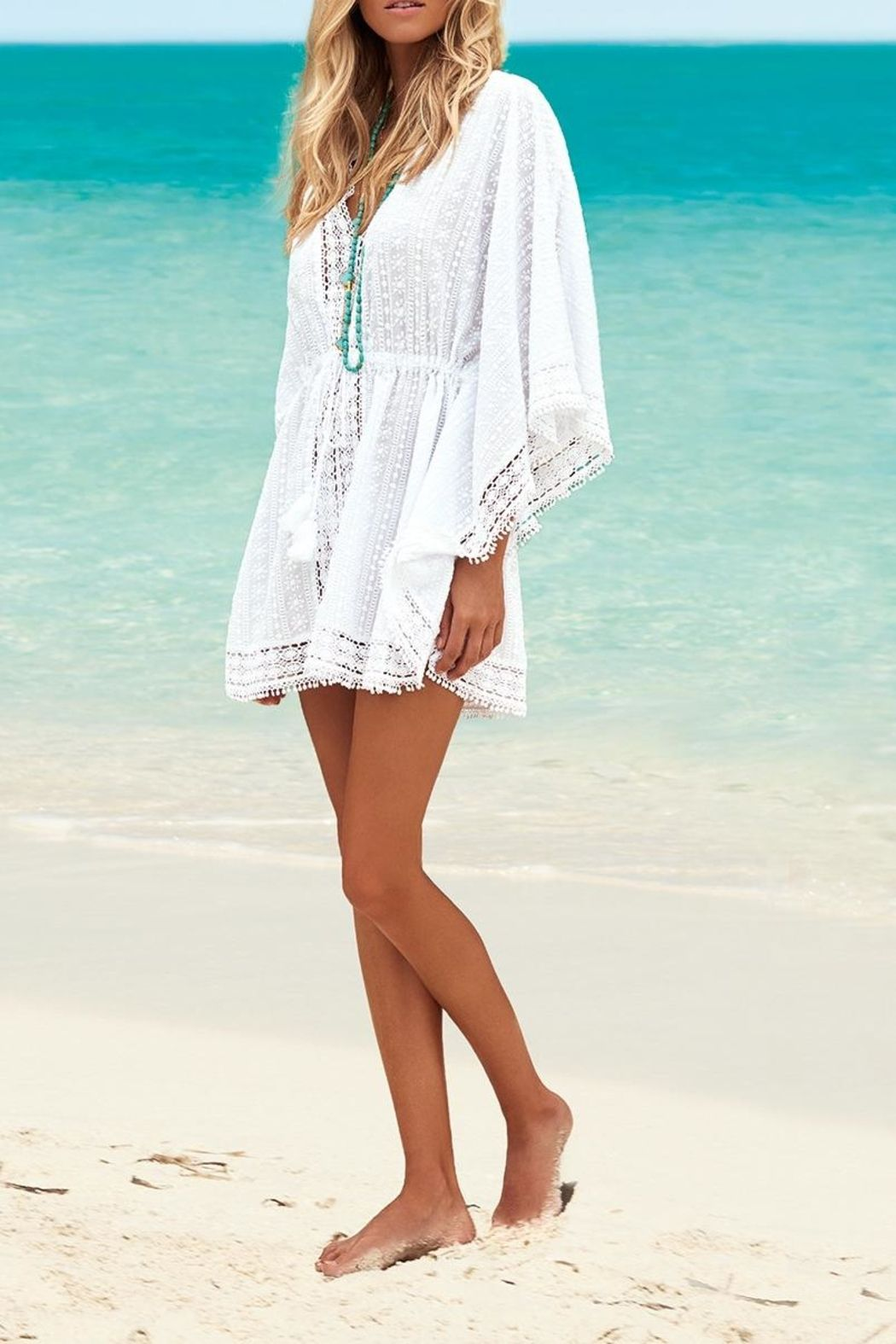 ff606d06e8 Encase your sun-kissed skin with the Gigi v-neck short kaftan in white, the  tan-enhancing crisp white is perfect for embodying timeless holiday style.