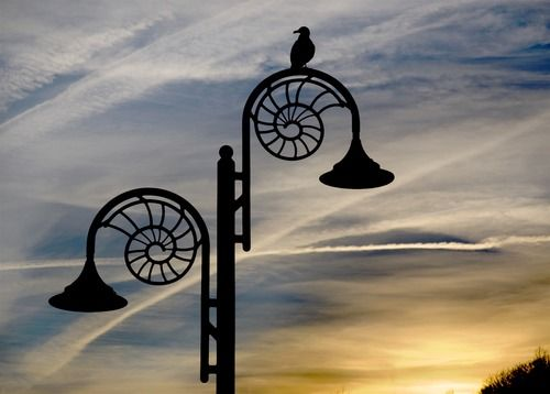 Ammonite-design streetlamps reflect the town's location on the Jurassic Coast