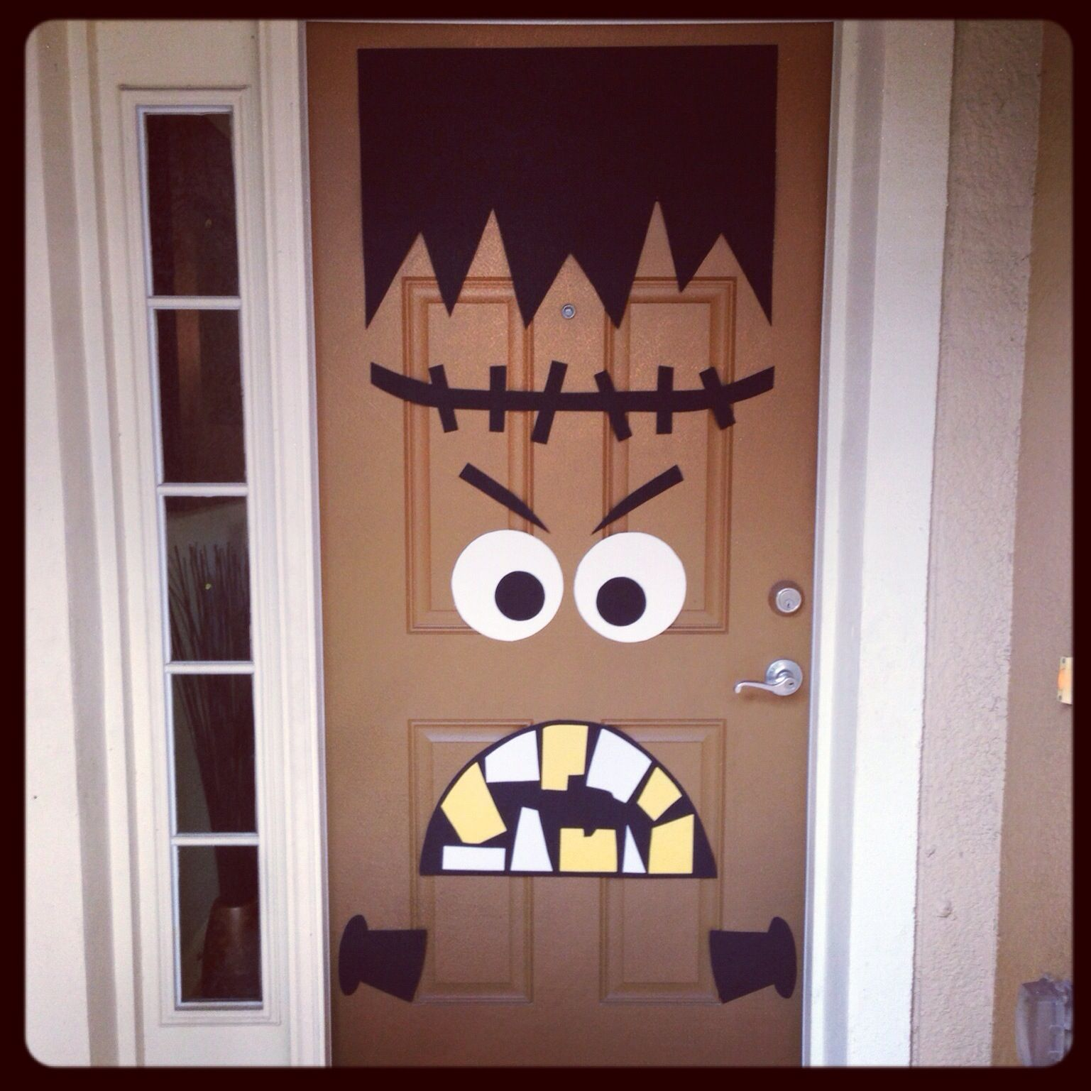 Front door Halloween decor! DIY Frankenstein Party Ideas - Halloween Door Decoration Ideas