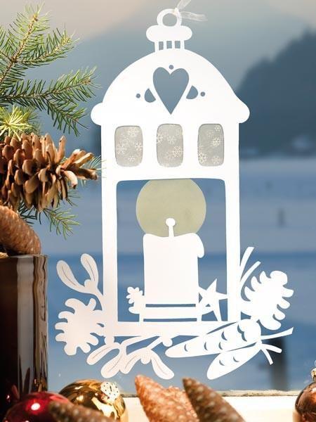 """<p><h2>Fensterbilder zu Weihnachten</h2></p><p><b>Strahlende Weihnachtslaterne</b></p><p>Dieses Laternen-Fensterbild macht die Wohnung zu Weihnachten heimelig. Viel Spaß beim gemeinsamen Basteln!</p><p><b> <a href=""""http://wohnidee.wunderweib.de/dekorieren"""