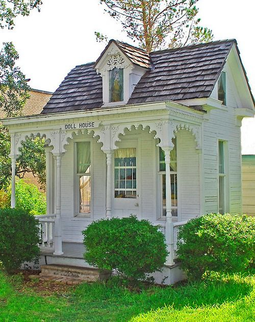 love the detail on the porch and windows