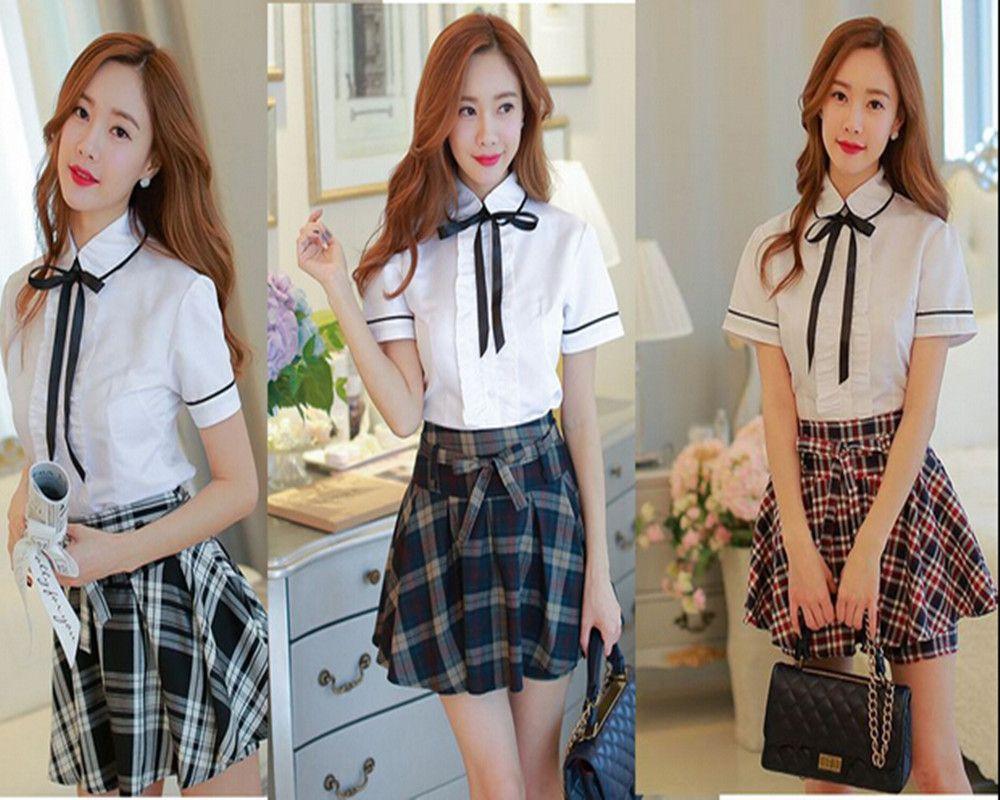 72ca21acb271e Uniformes Escolares A Cuadros Faldas de otoño Versión Coreana de la  Británica Estudiantes Japoneses Trajes Blancos de Manga Corta Chicas XX0