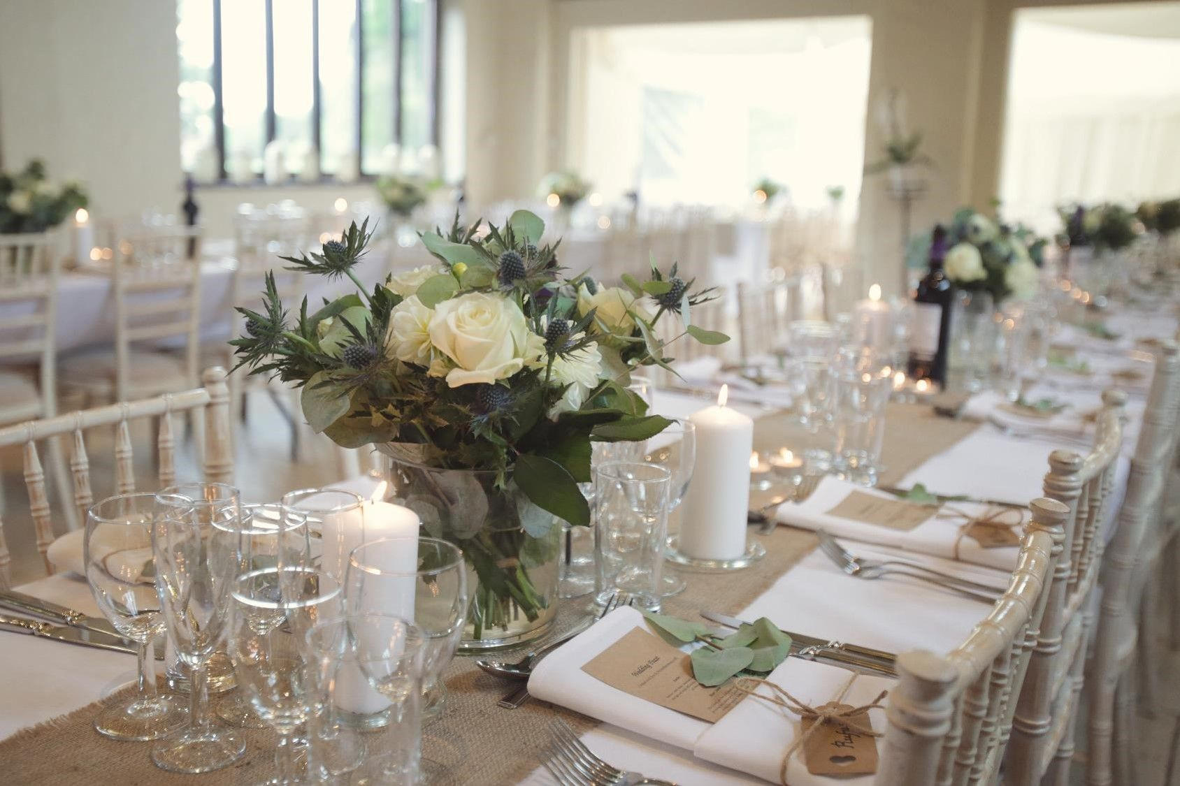 Bohemian chic country barn wedding table flowers and dressing. Blue ...