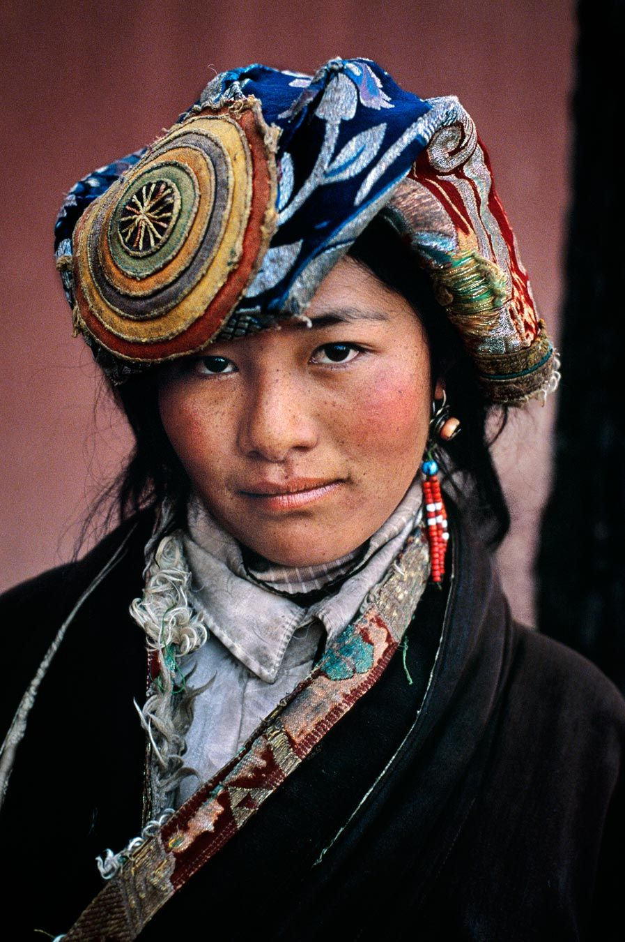 Asia | Portrait of a Tibetan woman wearing a traditional headdress, Potala Palace, Lhasa, Tibet | © Steve McCurry
