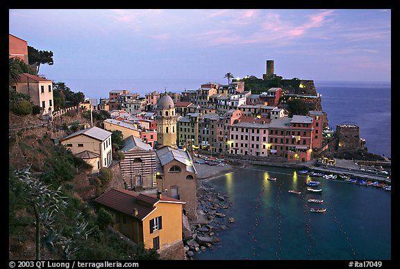 Harbor, church, medieval castle, and village, sunset, Vernazza, Cinque Terre, Liguria, Italy