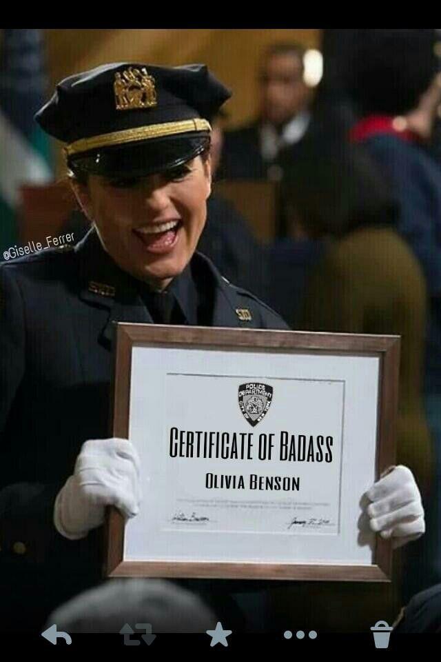 Mariska Hargitay holding her certificate in her uniform