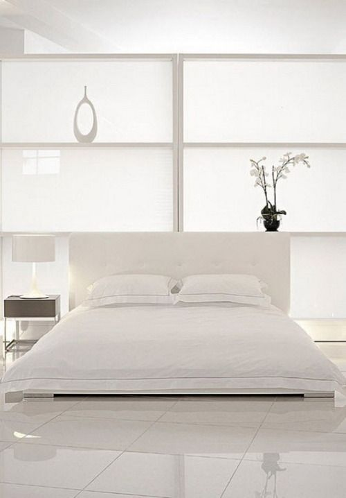 An all white bedroom symbolizes new beginnings.