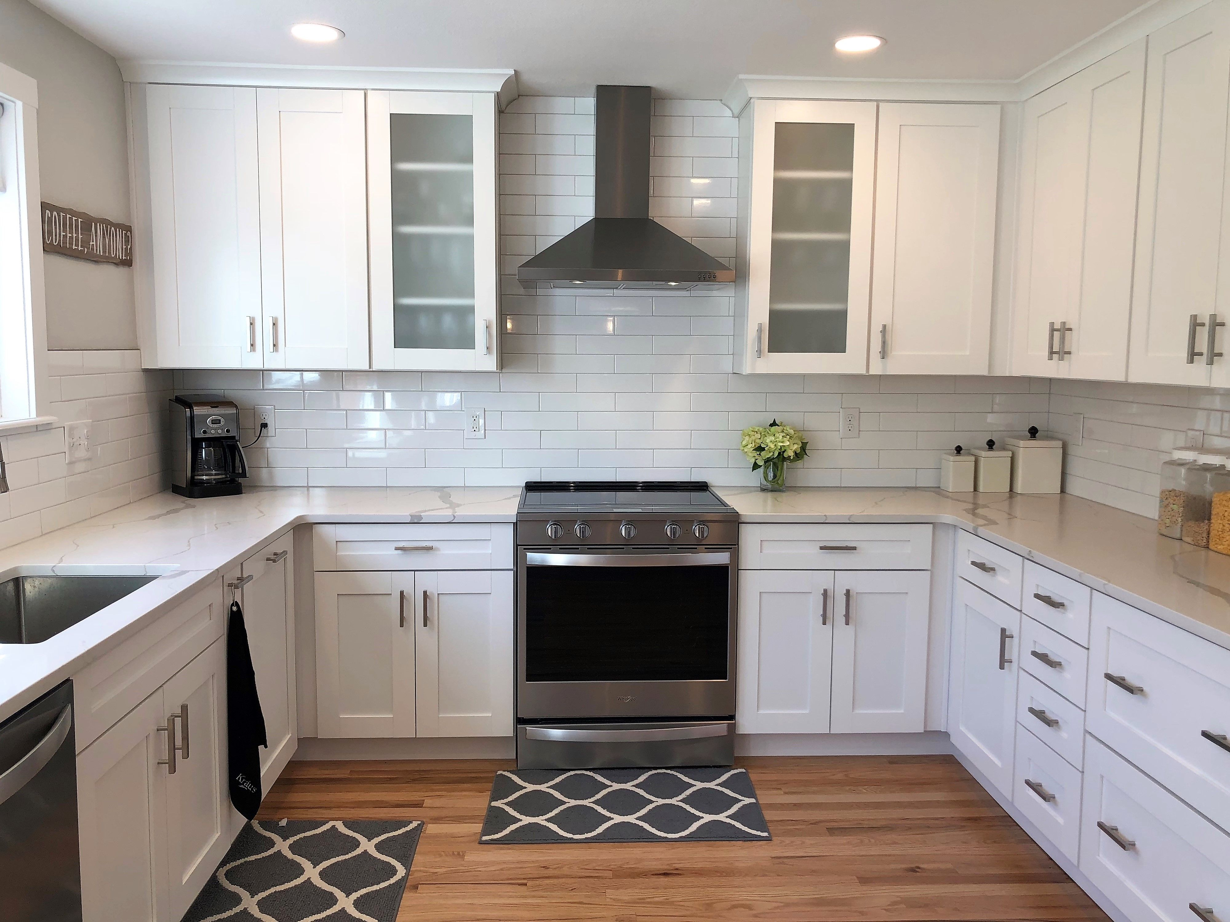 White Shaker Cabinets Are Paired With Stunning Wood Floor White