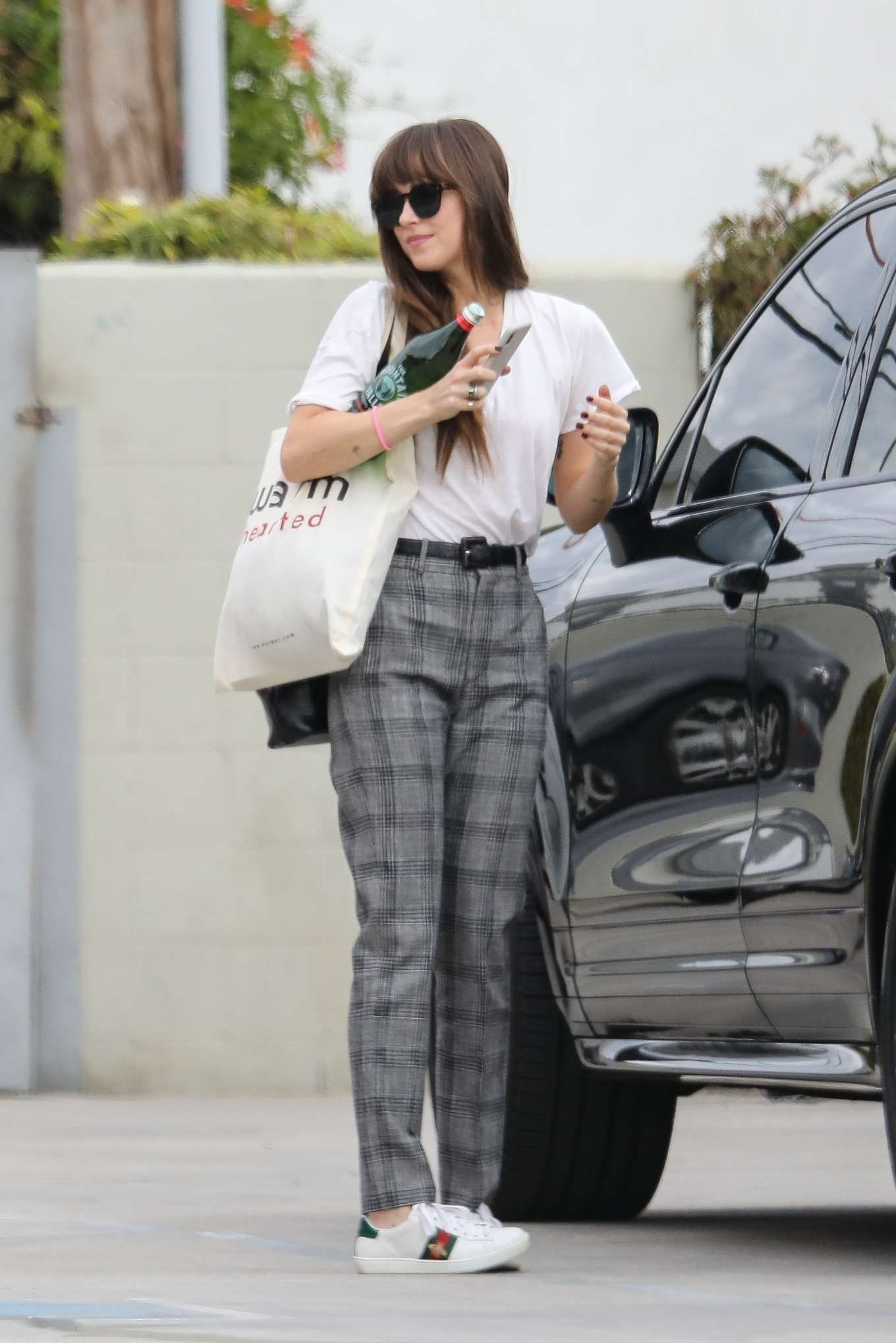 Dakota Johnson Grey Sweatshirt Street Style Autumn Winter 2020 on SASSY DAILY