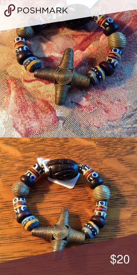 Trade bead and brass ethnic bracelet Lovely African trade bead and brass cross bracelet with carved wooden bead. Jewelry Bracelets