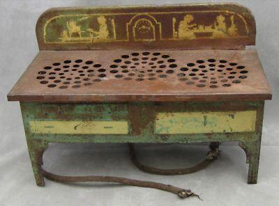 http://www.antiquesnavigator.com/d-526633/curious-antique-toy-stove-3-electric-burners-not-wkg.html