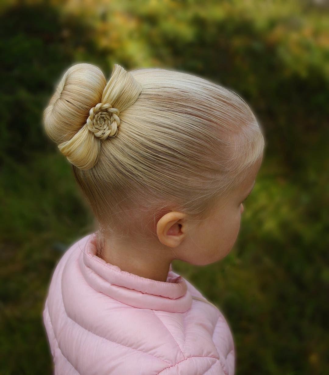 bun with a flower bow braid braids braided