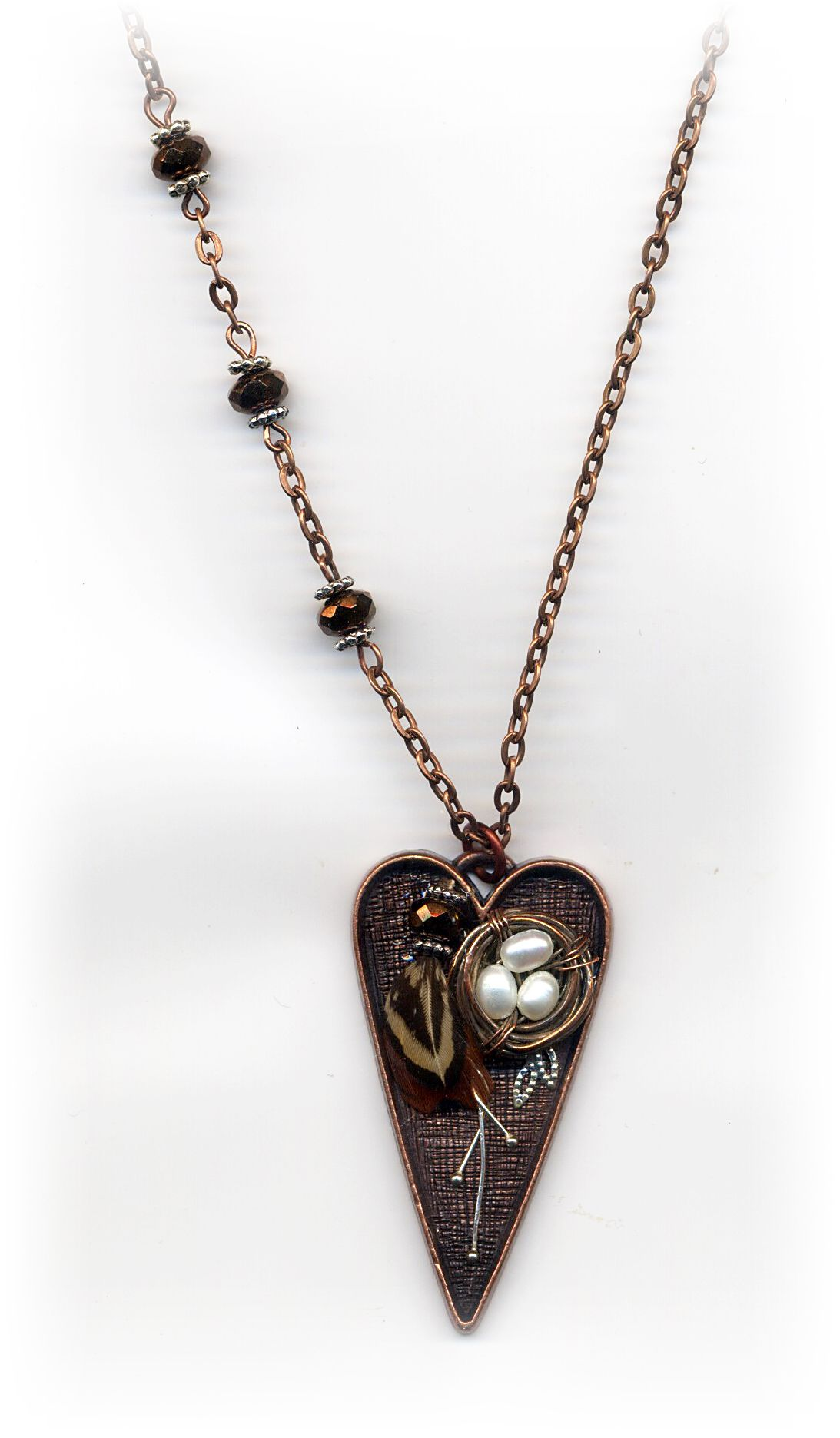 """Feather Your Nest"" necklace.  Like my facebook page at http://www.facebook.com/DWorrellMixedMediaArtAndJewelry"
