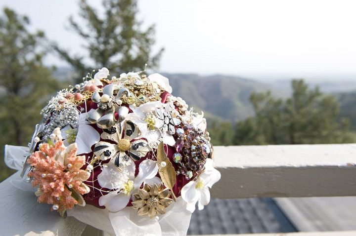 Bridal brooch bouquet + burgundy wedding theme for a barefoot wedding in the mountains of Colorado