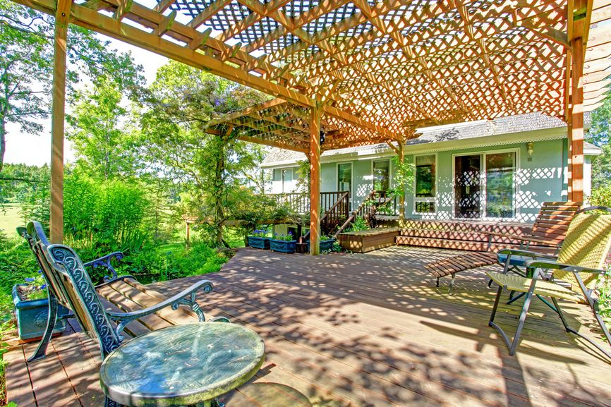 Large Deck Extending From Back Of Home With Overhead Trellis · Deck  CoveredWooden ...