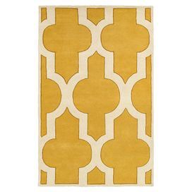 Hand-tufted rug with a lattice motif in gold.  Product: RugConstruction Material: WoolColor: Gold and whiteFeatures: Hand-tuftedNote: Please be aware that actual colors may vary from those shown on your screen. Accent rugs may also not show the entire pattern that the corresponding area rugs have.