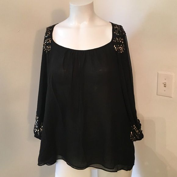 Parker blouse. New with tags Parker black top with gold accents. I bought on sale and never wore it. Parker Tops Blouses