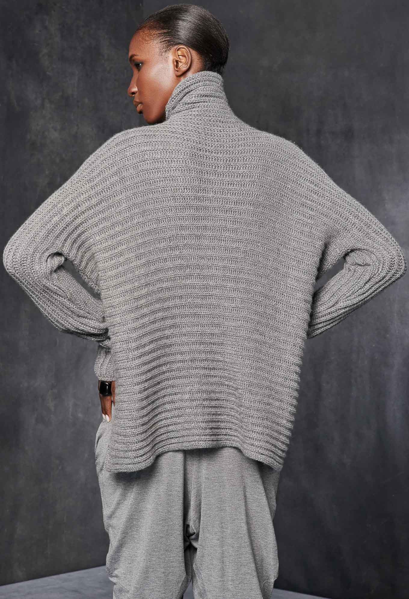 Relaxed horizontal rib knit high neck sweater. Additional Information 100%  CASHMERE Made of Italian