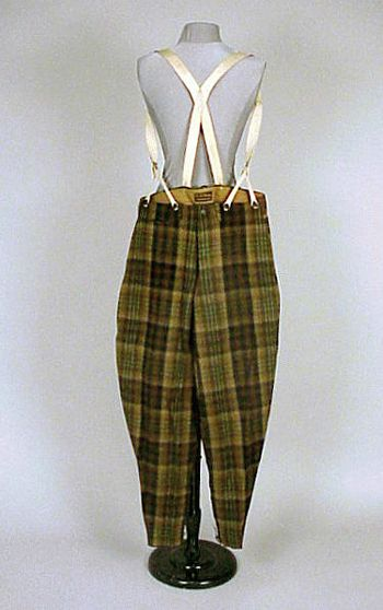 * L.L. Bean Plaid Wool Sports Pants Circa 1920 Of green, brown, tan, and black plaid wool, the wide legs tapering to narrow lacing at calf, button fly, braces, labeled