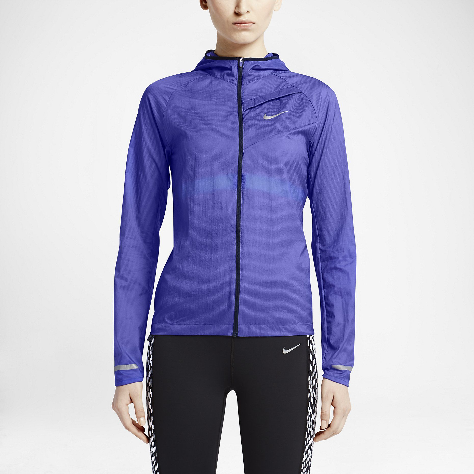 a3933fd6c0b5 Nike Impossibly Light Women s Running Jacket in sheer nylon with hood +  reflective details. Packs into its own chest pocket.