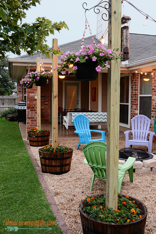DIY Patio Area with Texas Lamp Posts is part of Backyard diy projects, Diy backyard, Backyard projects, Diy patio, Backyard patio designs, Backyard decor - This DIY Patio Area with Sturdy Planted Posts is the perfect way to improve a small yard on a small budget  Easy tutorials and tips to follow for great backyard results