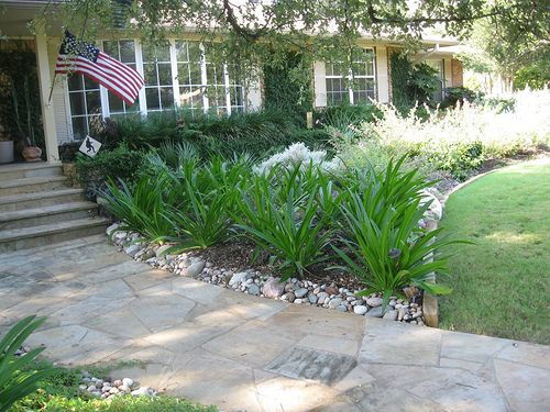 What Are This Bulbs I Like That The Landscaping Isn T Tall Front Yard Landscaping Landscape Design Small Yard Landscaping