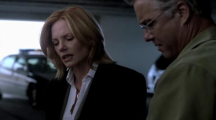 Marg Helgenberger and William Petersen in CSI: Crime Scene Investigation (2000)
